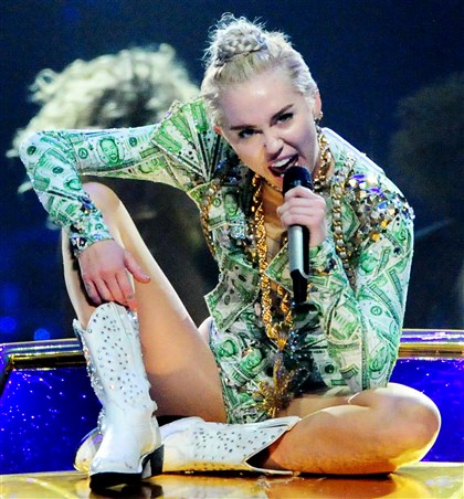 "20140804JHMAGMiley07  Miley Cyrus sings ""Love Money Party"" during her concert Monday night at Consol Energy Center."