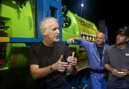 20140807HODeepSea1  Explorer and filmmaker James Cameron talks with his crew in front of the Deepsea Challenger submersible following a test dive in Jervis Bay, south of Sydney, Australia.
