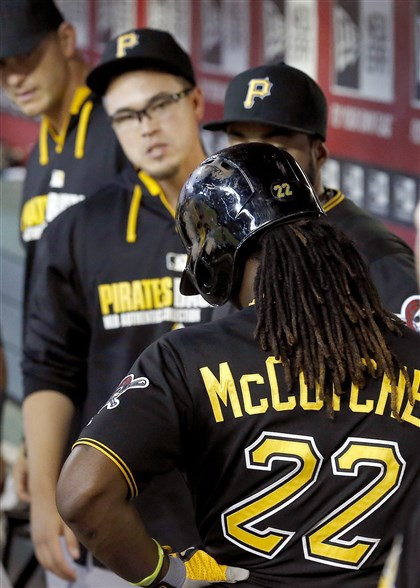 Pirates Diamondbacks Baseball Andrew McCutchen holds his side as he comes into the dugout after batting during the eighth inning of Sunday's baseball game against the Arizona Diamondbacks in Phoenix.