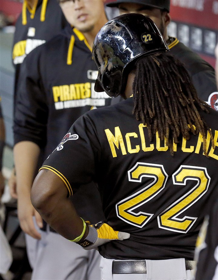 Pirates Diamondbacks Baseball Andrew McCutchen holds his side as he comes into the dugout after batting during the eighth inning against the Arizona Diamondbacks on Sunday in Phoenix.