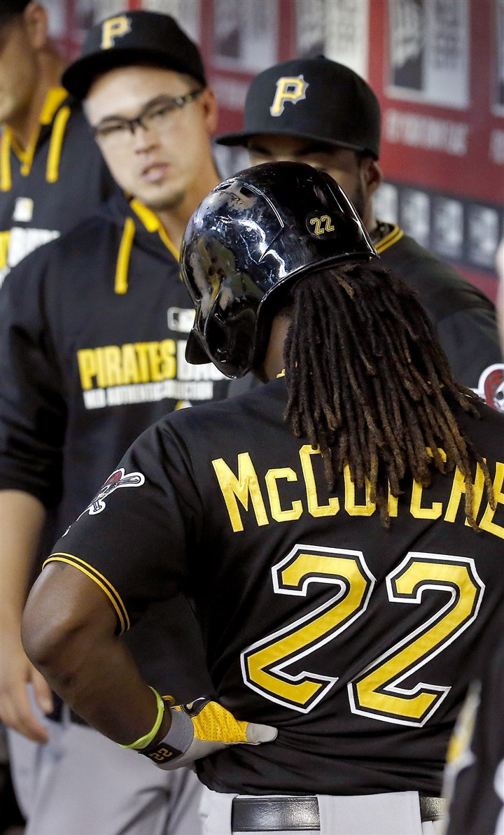 Pirates Diamondbacks Baseball Andrew McCutchen holds his side as he comes into the dugout after batting during the eighth inning of Sunday's game against the Arizona Diamondbacks.