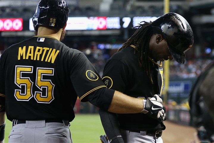 bucs0804e Teammate Russell Martin helps Andrew McCutchen off the field after McCutchen was injured during the eighth inning in Sunday's game against the Arizona Diamondbacks in Phoenix.