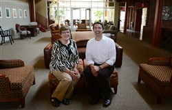 Carol Lennon and Michael Bowersox of Our Clubhouse, formerly Gilda's Club sit in the largest room of the clubhouse where family and friends can mingle and relax.