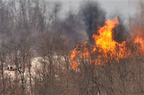A gas fire burns at a Marcellus Shale well in Greene County in February 2014.