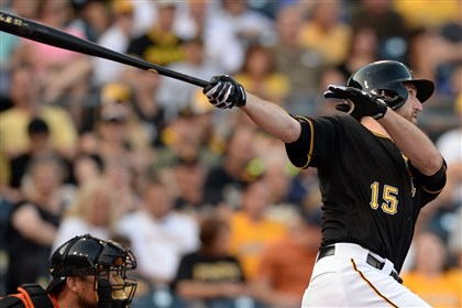 20140806mfbucssports03-1 Pirates' Ike Davis hits a two-run double against the Marlins in the first inning at PNC Park.