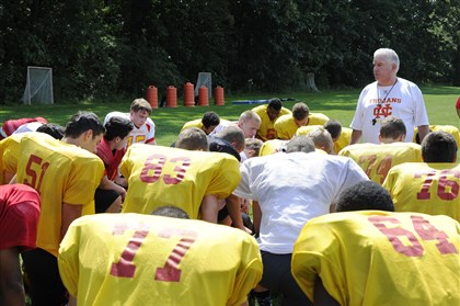North Catholic High School  North Catholic High School Football coach Bob Ravenstahl begins practice with a prayer.