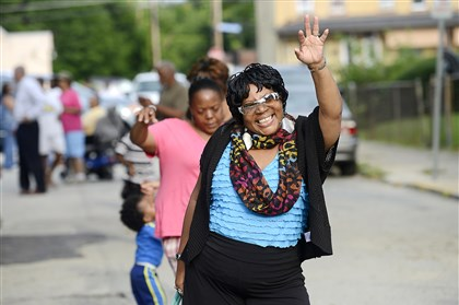 National Night Out Lorraine Cross, of the East Hills, line dances during a National Night Out event in the 7000 block of Monticello Street in Homewood on Tuesday evening.