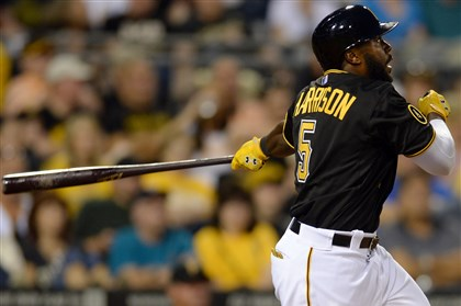 20140805mfbucssports08-2 Josh Harrison doubles against the Marlins in the sixth inning at PNC Park Tuesday night.