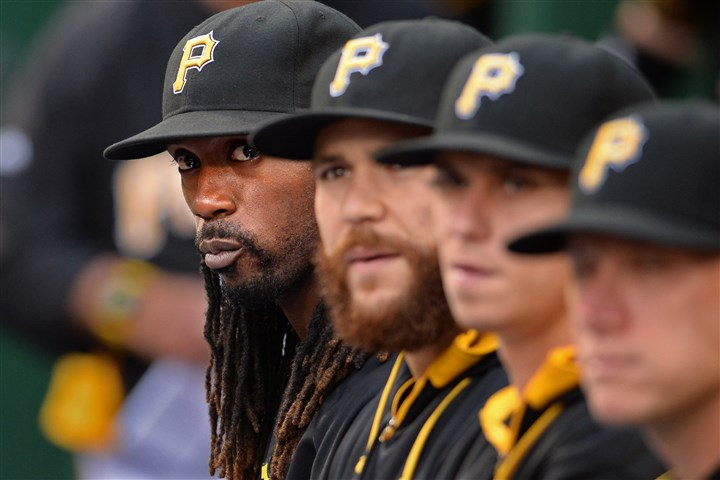 20140805mfbucssports04-3 Pirates' Andrew McCutchen sits on the bench as his team takes on the Marlins at PNC Park. McCutchen has been diagnosed with a rib fracture.