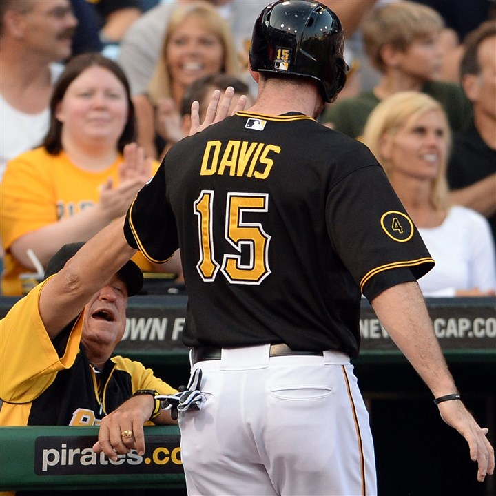 20140806mfbucssports02 Pirates manager Clint Hurdle congratulates Ike Davis after scoring against the Marlins in the first inning at PNC Park. Davis his a two-run double in the inning.
