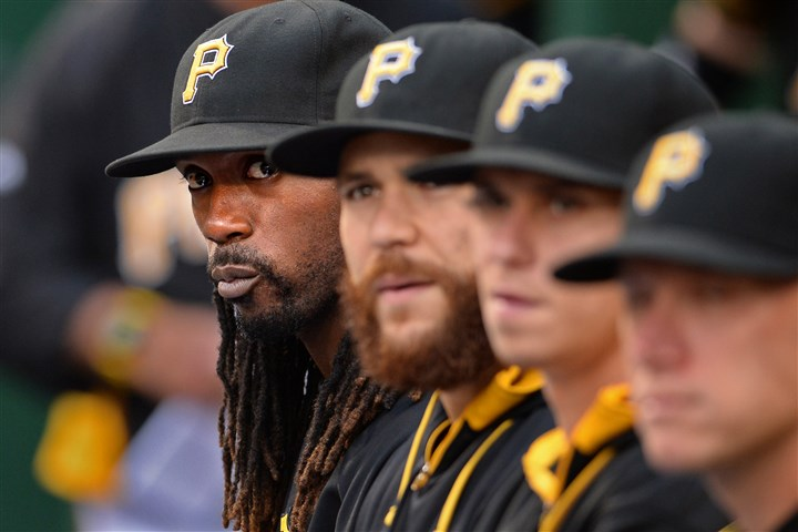 20140805mfbucssports04-3 Andrew McCutchen sits on the bench as his team takes on the Marlins at PNC Park Tuesday night. McCutchen has been diagnosed with a rib fracture.