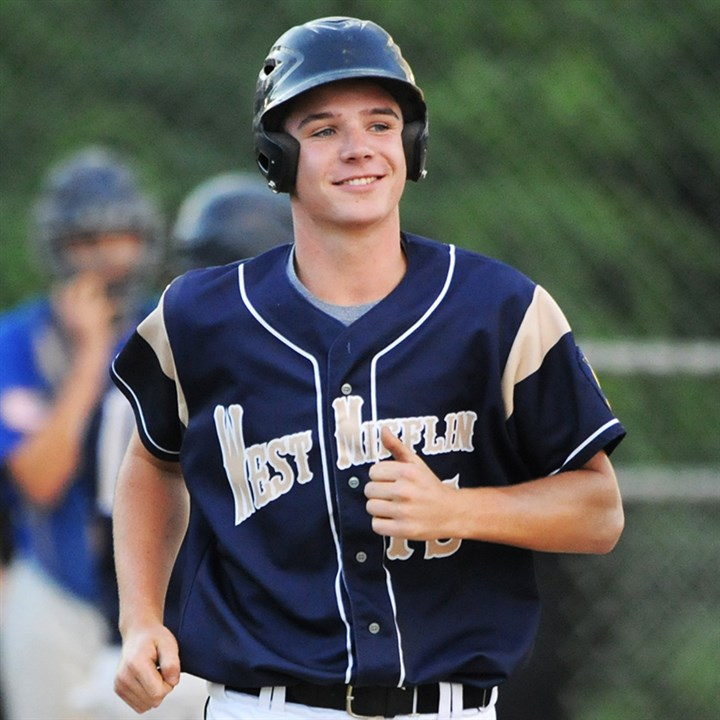 20140730CMAmLegionSports001.jpg First baseman Joe Stavor is all smiles as he runs to first base in an American Legion baseball game against Chartiers Valley/South Fayette last month.