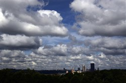 Clouds scatter about the sky over the Downtown skyline.