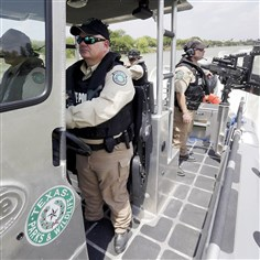 POOL In this July 24 file photo, Texas Parks and Wildlife wardens patrol the Rio Grande on the U.S.-Mexico border in Mission, Texas. Texas is spending $1.3 million a week for a bigger Department of Public Safety presence along the border.