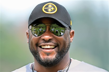 20140807pdSteelersSports00 Steelers head coach Mike Tomlin shares a laugh with the running backs during afternoon workouts last week at training campat Saint Vincent College in Latrobe.