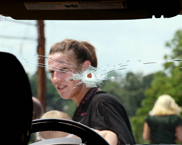 20140807MWHshootingLocal01 Amy Calabrese, seen here behind a bullet hole, gives interviews on Thursday, next to the SUV where Baldwin police shot her boyfriend, the father of one of her children, Rich DeSabetino as he fled from police the day before on Bonni Drive.