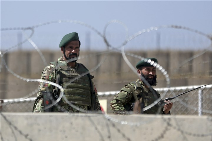 Afghanistan Afghanistan National Army soldiers stand guard at a gate of Camp Qargha, west of Kabul, Afghanistan, on Tuesday.