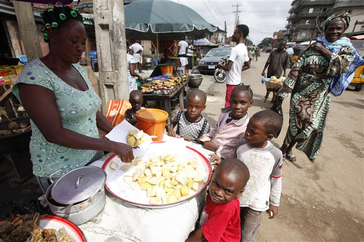 West Africa Ebola 0807 Children buy fried potatoes on a street in Lagos, Nigeria today. West Africans battling to contain the spread of Ebola will have to wait for months until a potentially life-saving experimental drug used on two Americans infected with the dreaded disease could even be made, officials said.