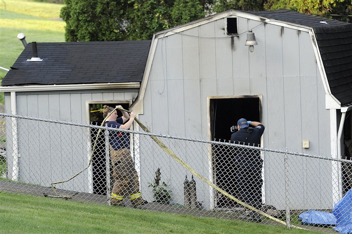 20140807radKennedyFatalFireLocal02.jpg The Allegheny County fire marshal begins his investigation as Kennedy firefighters clean up after a fatal fire at the Ahavath Achim Cemetery on Green Oak Drive in Kennedy this morning.