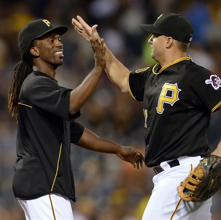 20140806mfbucssports11-6 Andrew McCutchen congratulates Gaby Sanchez after the Pirates' 7-3 win against Miami at PNC Park Wednesday night.