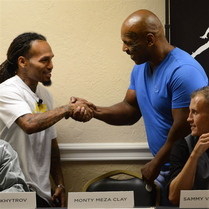 20140807MWHtysonSports01 Former Heavyweight Champion Mike Tyson shakes hands with fighter Monty Meza Clay of Rankin during a press conference Thursday at The Boiler Room on Banksville Road for The Pride of Pittsburgh boxing event at Consol Energy Center this weekend. Local product Sammy Vasquez Jr. is at far right.