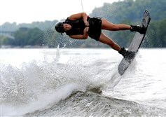 Becky Miller, 21, of Shaler, does a heelside back roll while wakeboarding on the Allegheny River Aug. 6.