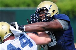 Pitt's T.J. Clemmings, right, battles with David Durham in a drill during an August practice at the team's South Side facility. Clemmings will participate in the 2015 NFL Combine.