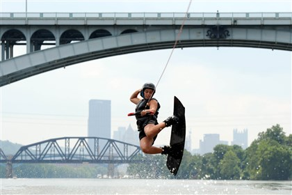 20140806MWHwakeboardNorth01 Becky Miller, 21, of Ross, does a fashion air while wake boarding on the Allegheny River on Aug. 6, 2014.