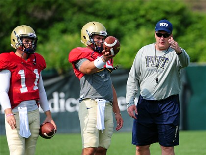 20140808lfPittSports01 Pitt coach Paul Chryst instructs quarterbacks Chad Voytik, center and Trey Anderson in training camp earlier this month.