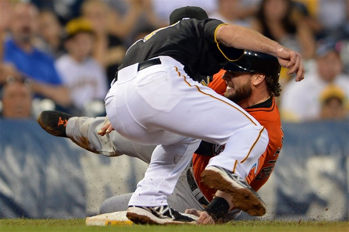 20140807mfbucssports08-4 Pirates' Jayson Nix tags out Marlins' Jarrod Saltalamacchia at third base in the fifth inning.