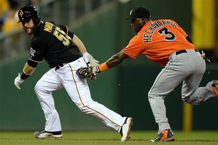 20140807mfbucssports09-5 Pirates' Russell Martin is tagged out between second and third base by Marlins' Adeiny Hechavarria in the fifth inning.