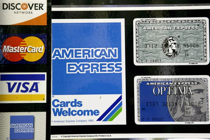 Consumer Borrowing FILE - In this Sept. 5, 2007 file photo, credit card decals adorn a store window in the Hollywood section of Los Angeles. The Federal Reserve reports on consumer borrowing data for June 2014 on Thursday, Aug. 7, 2014. (AP Photo/Nick Ut, File)