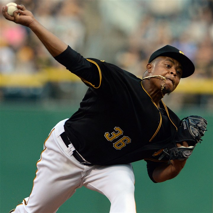 Parents-6 Pirates pitcher Edinson Volquez pitches against the Marlins at PNC Park.