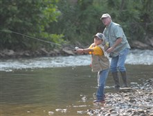 Haden Kohler, 7, and his father Tom Kohler, of Scott, fish in Chartiers Creek druing Heidelberg's annual fishing derby in 2014.