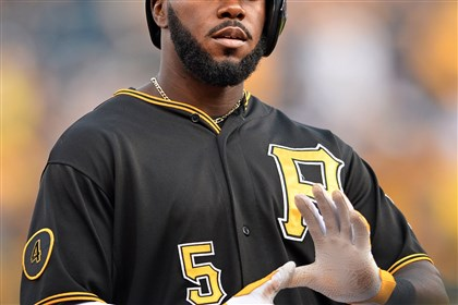 "20140808mfbucssports04.jpg The Pirates' Josh Harrison flashes the ""Zoltan"" sign after hitting a triple against the Padres in the first inning at PNC Park Friday night."