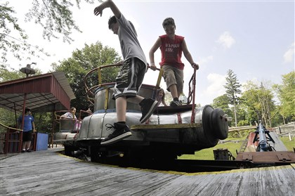 Jonah Steele, left, and Dominic Pascarella Jonah Steele, left, and Dominic Pascarella, exit the Tumble Bug at Conneaut Lake Park in Conneaut Lake, Pa. earlier this week.