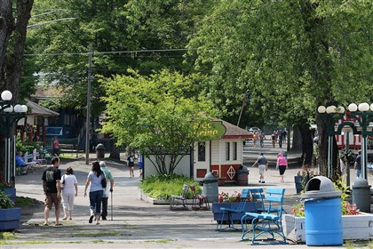 Conneaut Lake Park  In this Aug. 1, 2014 photo, guests walk along the midway at Conneaut Lake Park in Conneaut Lake, Pa.