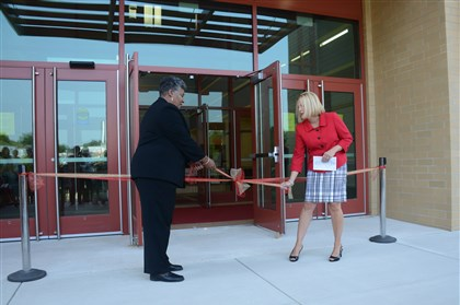 Penn Hills school board president Denise Graham-Shealey Penn Hills school board president Denise Graham-Shealey, left, and Penn Hills Elementary School principal Kristin Brown untie the ribbon during the new Penn Hills Elementary School opening ceremony on Saturday.