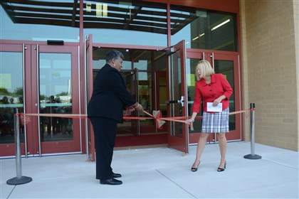 Penn Hills Elementary school opening Penn Hills school board president Denis Graham-Shealey, left, and Penn Hills Elementary principal Kristin Brown untie the ribbon during the school's opening ceremony Saturday.