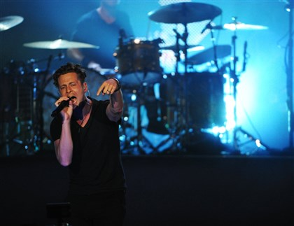 20140808OneRepublic8-3 OneRepublic's Ryan Tedder at First Niagara Pavilion in Burgettstown.