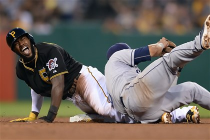 Pirates' Josh Harrison grimaces Pirates' Josh Harrison grimaces as Padres' Evereth Cabrera rolls onto his left ankle during a steal attempt in the fifth inning at PNC Park Friday night. Harrison was out on the play and stayed in the game.