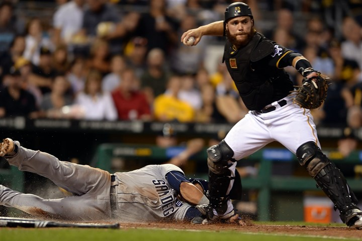 Pirates' Russell Martin turns a double play Pirates' Russell Martin turns a double play as he gets Padres' Evereth Cabrera out at home plate in the sixth inning at PNC Park Friday night.