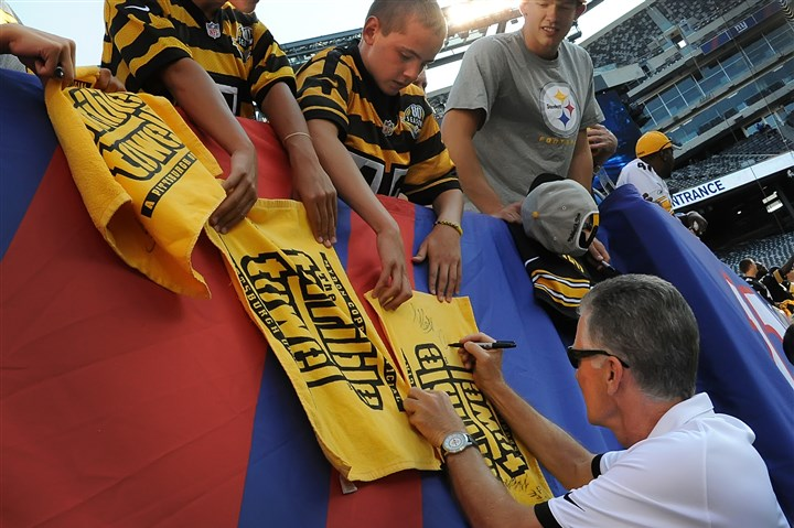 rooneytowel Pittsburgh Steelers president Arthur J. Rooney II signs Terrible Towels prior to the team's first preseason game against the Giants at MetLife Stadium.