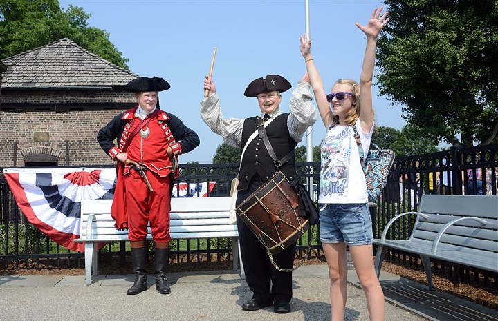 20140809lfHouseLocal02-1 Drummer Jim Smith demonstrates to Sarah Hughes, 11, of Hanover, N.J., a marching signal as Gen. George Washington (played by Bill Choby) looks on during the 250th-year celebration of the Fort Pitt Block House at Point State Park, Downtown, on Saturday.