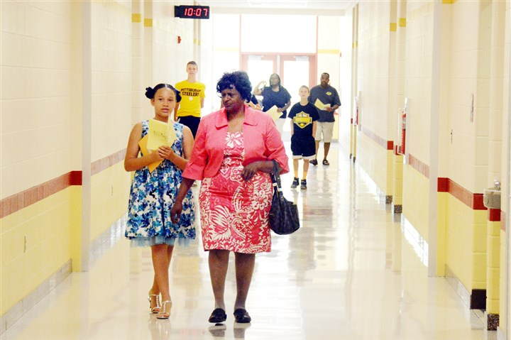 Penn Hills Elementary opening Fourth-grader Annabelle Little, left, 9, and her grandmother Melvinor Jones, 66, tour the new Penn Hills Elementary School after the opening ceremony Saturday.