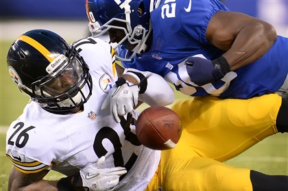 Amukamara leveon bell The Giants' Prince Amukamara strips the ball from Steelers running back Le'Veon Bell in the first half at MetLife Stadium.