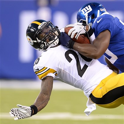 20140809pdSteelersSports05-3 Steelers running back Le'Veon Bell is stopped by the Giants' Prince Amukamara during a preseason game earlier this month at MetLife Stadium in East Rutherford, N.J.