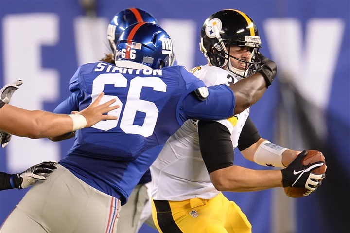20140809pdSteelersSports14 The Giants' Jordan Stanton sacks Steelers quarterback Landry Jones in the fourth quarter at MetLife Stadium.