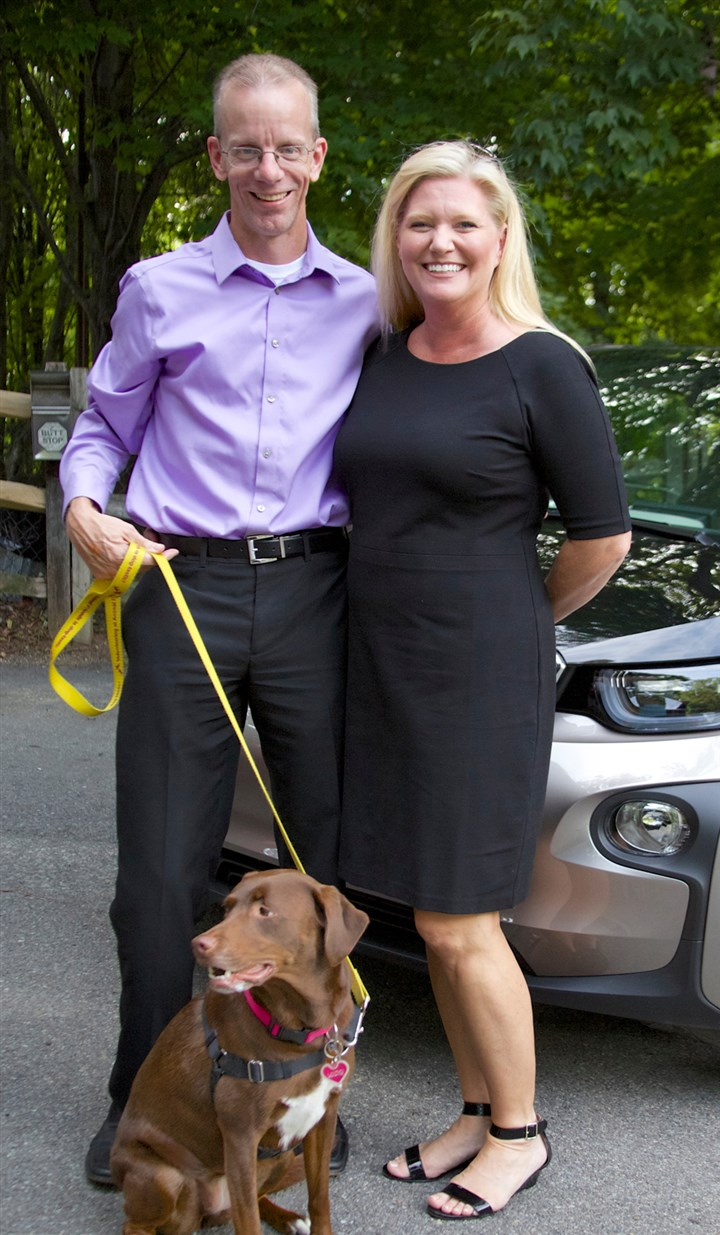 20140810hoManiac2seen Animal Friends president and CEO, David Swisher, with wife Patty and dog Lucky.