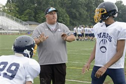 "Mars football coach Scott Heinauer: ""We're teaching proper technique. That's important, way more important than just banging people."""